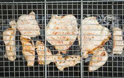 Chicken grilling on the brazier Stock Images