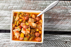 Chicken Gumbo Soup on barn table Stock Image