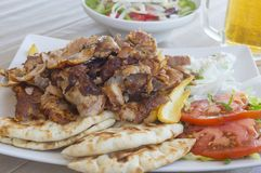 Chicken gyros in a plate offset Royalty Free Stock Images