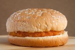 Chicken hamburger. On brown background Royalty Free Stock Photos