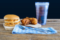 Chicken hamburger and fried chicken, glass of cola on wooden cut Stock Image