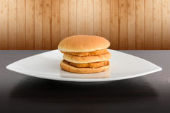 Chicken hamburger in white plate , on top table Stock Photo