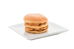Chicken hamburger on white plate and white backgroung Royalty Free Stock Images