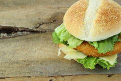 Chicken hamburger on wooden board with space to write text. Chicken hamburger on old wooden board with space to write text Stock Image