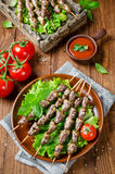 Chicken hearts on a barbecue sticks topped with sesame seeds Stock Photos