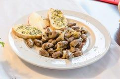 Chicken hearts, garlic bread, Tapas Stock Image