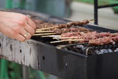 Chicken hearts kebabs on grill Stock Image
