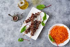 Chicken hearts in spicy sauce and carrot salad. Healthy food. Top view stock photo