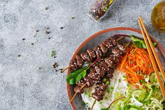 Chicken hearts in spicy sauce, noodles and vegetable salad. Healthy food. Top view stock photos