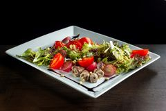 Chicken hearts, vegetable salad. royalty free stock photo