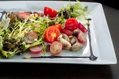 Chicken hearts, vegetable salad. stock image