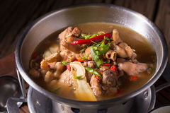 Chicken and herb soup in pot.  royalty free stock photo