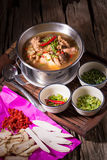 Chicken and herb soup in pot.  royalty free stock image