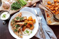 Chicken in herbs with fried potatoes Stock Image