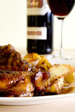 Chicken on honey with wine. Chicken on honey with potatoes and red wine Stock Photo