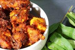 Chicken 65, an Indian chicken appetizer. Chicken 65, an Indian appetizer chicken morsels in spicy mix and deep fried in oil, selective focus Stock Photo