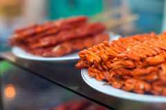 Chicken intestines, pig ears and pig intestines barbeque screw,. Chicken intestines, pig ears and pig intestines - barbeque on stick, local food in the Royalty Free Stock Image