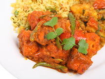 Chicken Jalfrezi. Indian curry with chicken jalfrezi, pilau rice and Bombay aloo Stock Photo