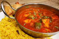 Chicken jalfrezi in balti dish with rice royalty free stock images