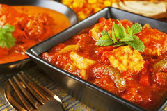 Chicken Jalfrezi Curry. Chicken Jalfrezi with a selection of other Indian food Royalty Free Stock Images