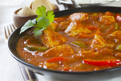 Chicken Jalfrezi Curry. Chicken Jalfrezi with rice and poppadums. This curry was invented by Indian chefs in the time of the Raj, when left over roast chicken Stock Photos