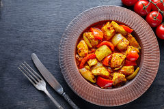 Chicken jalfrezi Indian restaurant fried spicy curry chilli meat and vegetables healthy food Stock Photos