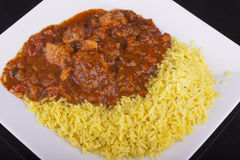 Chicken jalfrezi with pilau rice Royalty Free Stock Photography