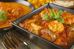 Chicken Jalfrezi Curry. Chicken Jalfrezi with a selection of other Indian food Royalty Free Stock Photos