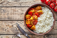 Chicken jalfrezi traditional homemade Indian spicy curry chilli meat with rice. And vegetables healthy dietetic asian food in clay dish on vintage table Royalty Free Stock Photos