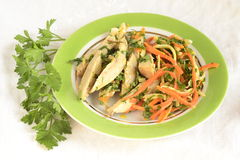 Chicken with julienne carrots and celery Royalty Free Stock Image