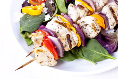 Chicken kabob. Grilled chicken with salad and rice pilaf Royalty Free Stock Photography