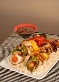 Chicken kabobs on rice stock photos
