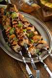 Chicken kabobs with sweet and sour sauce Stock Photo