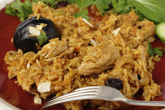 Chicken kabsa dinner from above. An authentic Saudi chicken kabsa (known in Qatar as majbous), garnished with raisins and toasted almond flakes, on a serving Stock Photo