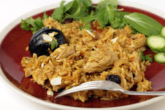 Chicken kabsa dinner. An authentic Saudi chicken kabsa (known in Qatar as majbous), garnished with raisins and toasted almond flakes, on a serving bowl. Kabsa is Royalty Free Stock Photos