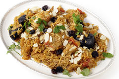 Chicken kabsa on a serving plate. An authentic Saudi chicken kabsa (known in Qatar as majbous), garnished with raisins and toasted almond flakes, on a serving Stock Photography