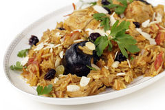 Chicken kabsa on a serving plate. An authentic Saudi chicken kabsa (known in Qatar as majbous), garnished with raisins and toasted almond flakes, on a serving Royalty Free Stock Image