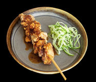 Chicken karaage with lemon peel and lemon sauce Stock Photo