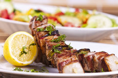Chicken kebab. Grilled chicken kebab served with a fresh salad Royalty Free Stock Images