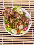 Chicken kebab. Grilled chicken kebab served with a fresh salad Stock Images