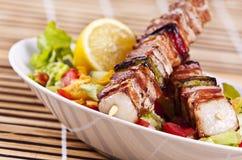 Chicken kebab. Grilled chicken kebab served with a fresh salad Stock Photos