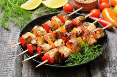 Chicken kebab on bamboo skewers. In frying pan stock photography