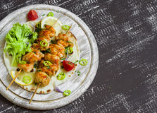 Chicken kebab, fresh salad and homemade tortilla on a light wooden Board Royalty Free Stock Image