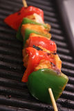 Chicken kebab on grill. Chicken kebab with bell pepper on the bbq grill royalty free stock image