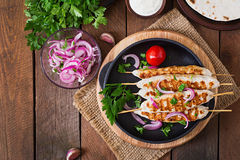 Chicken kebab with grilled vegetables. Top view Royalty Free Stock Image