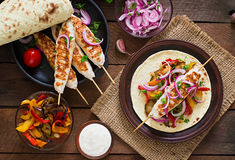 Chicken kebab with grilled vegetables. Top view. Chicken kebab with grilled vegetables and tortilla wrap. Top view Royalty Free Stock Image