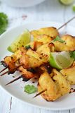 Chicken kebab and lime. Chicken kebabs on sticks with lime and coriander Stock Photography