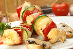 Chicken kebab on a plate with organic pepper Stock Photo
