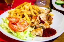 Chicken kebab. With potatoes and salad Royalty Free Stock Images