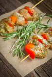 Making kebabs from chicken - raw meat on skewers stock photo